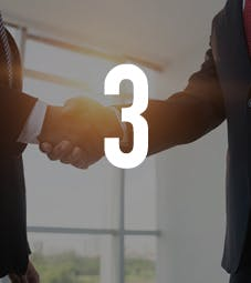Business School - Homepage - Why Choose Us Flip Card - Accreditations - Two men shaking hands