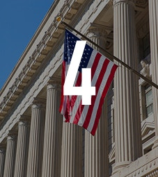 Law School - Homepage - Why Choose Us Flip Card - American Internship Programme - American flag outside a town hall
