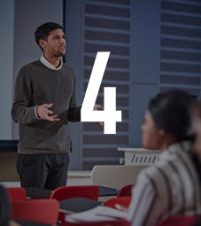Business School - Homepage - Why Choose Us Flip Card - International Focus - Man addressing a class