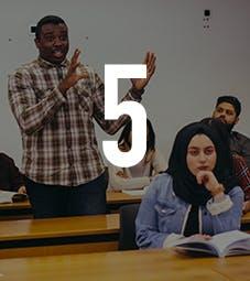 Law School - Homepage - Why Choose Us Flip Card - International Focus - Man addressing classroom