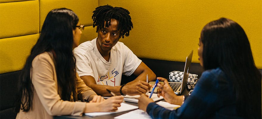 5 Sociology Reasons 880x400 - People sat at a table