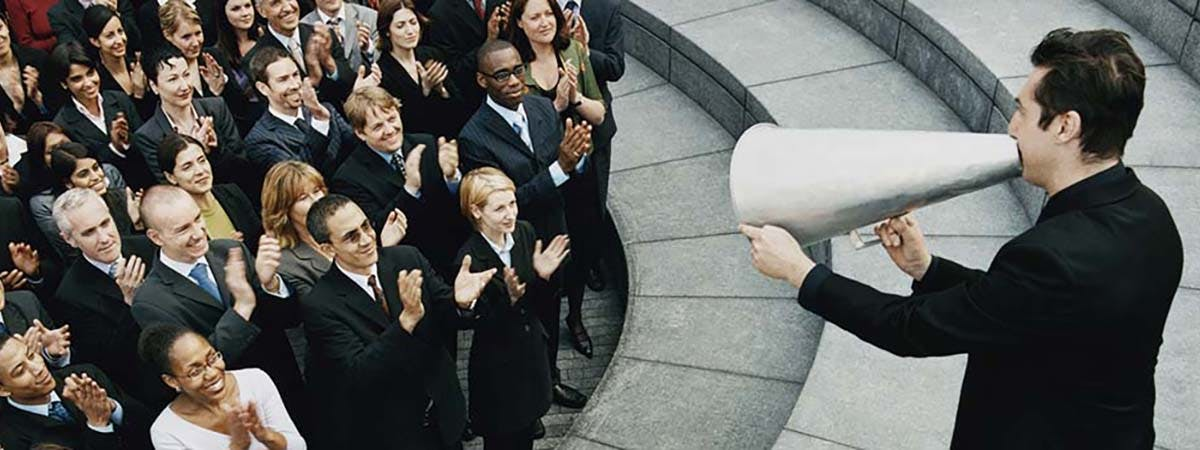 7 Event Management Reasons 1200x450 - Man speaking with a loudspeaker to a crowd of people