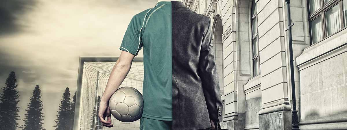 7 Sport Management 1200x450 - Man holding a football and a suitcase