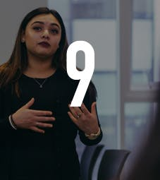 Law School - Homepage - Why Choose Us Flip Card - Expert Talks - Woman addressing a classroom