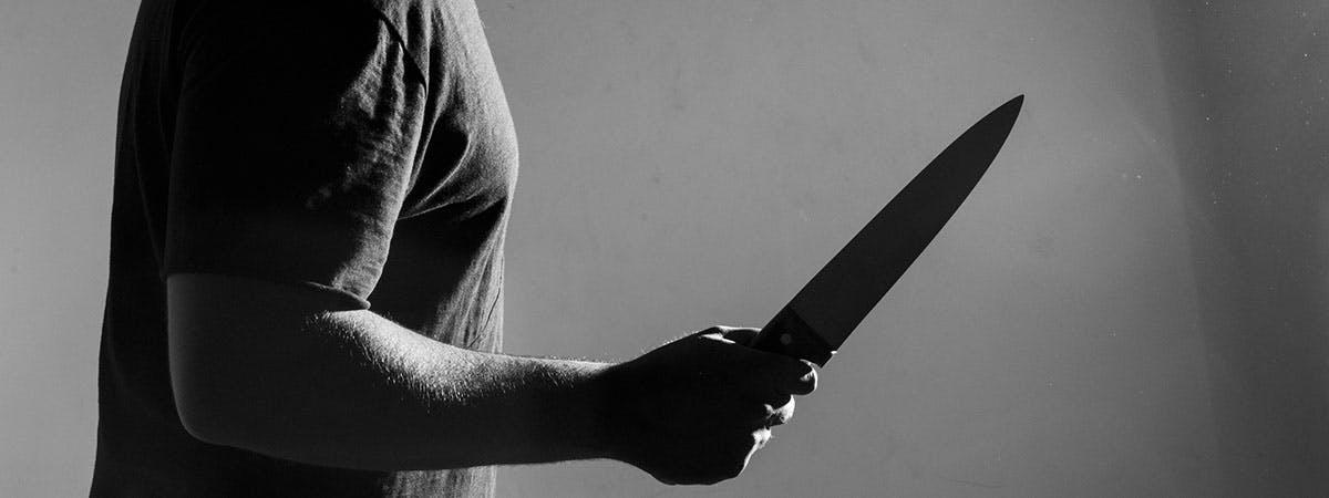 Neoliberalism 1200x450 - Man holding knife