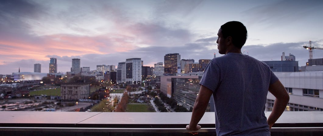 Photo of person looking out across Birmingham from Curzon balcony.