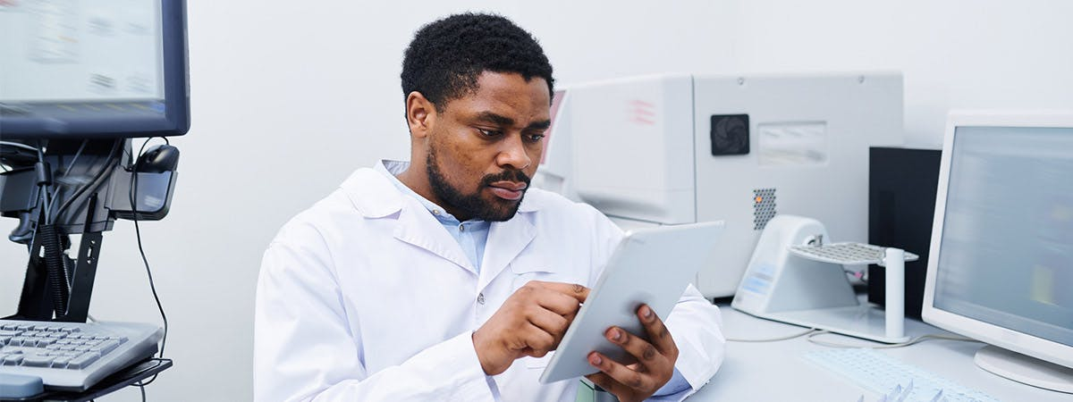 An academic clinician looking over a report