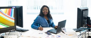 MAcc Accounting and Finance Course Image - Girl sat at computer desk
