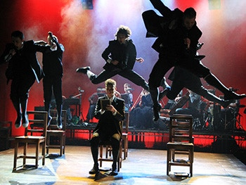 Acting students jumping from chairs