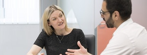 Insurance and Risk Management Course Image 2 1200x450 - Woman talking to a man
