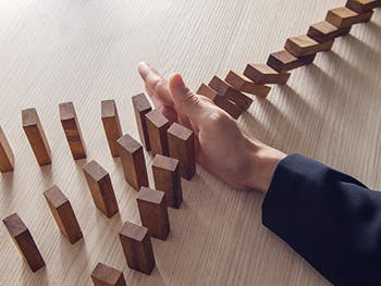 Centre for Brexit Studies Administrations Image 350x263 - Hand dividing a row of dominoes into three