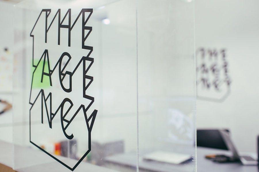 VisCom The Agency sign