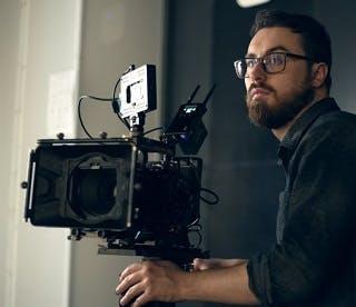 Media graduate operating a TV camera