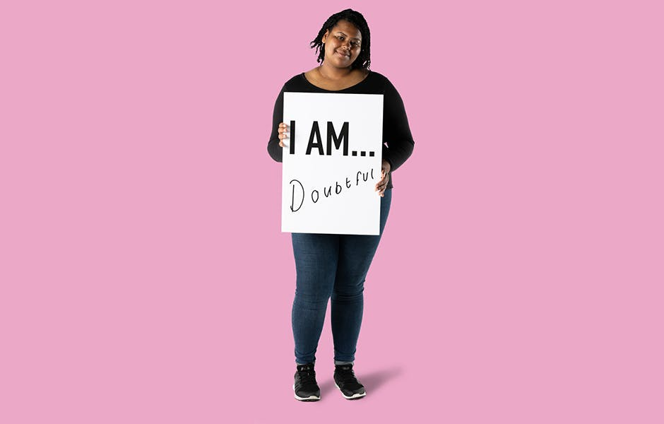 Student Asia Morton holding a sign saying 'I AM doubtful'.