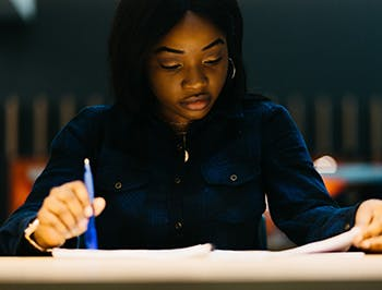 BLSS Personal Statements Page Image 350x266 - Woman writing at a table