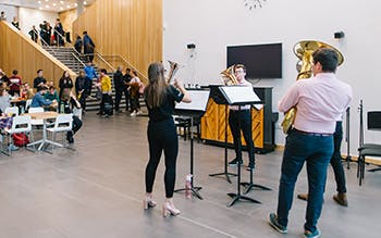 Brass band performers in RBC atrium at Open Day