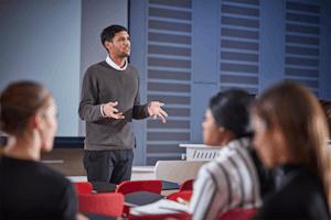 Photo of man talking at a workshop