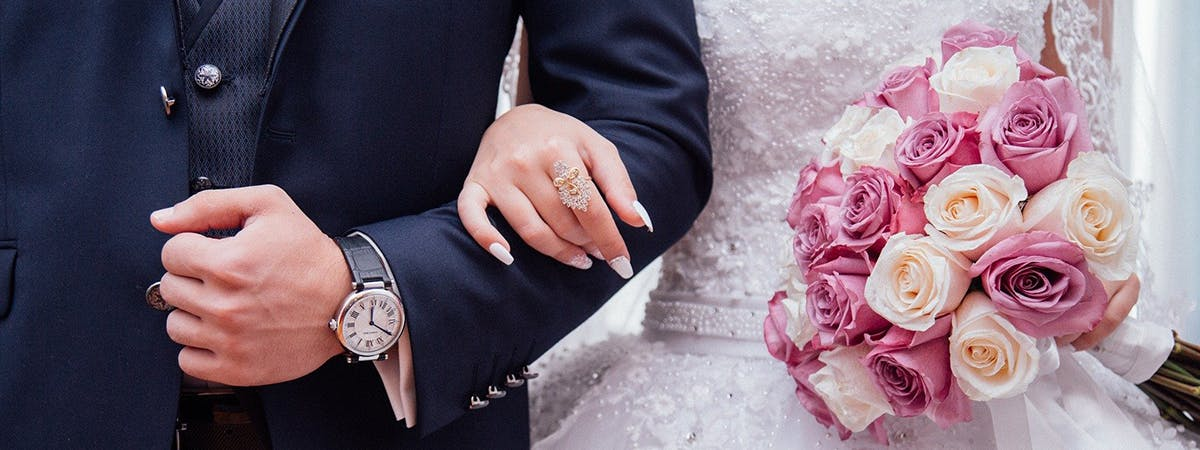 A bride and groom arm in arm