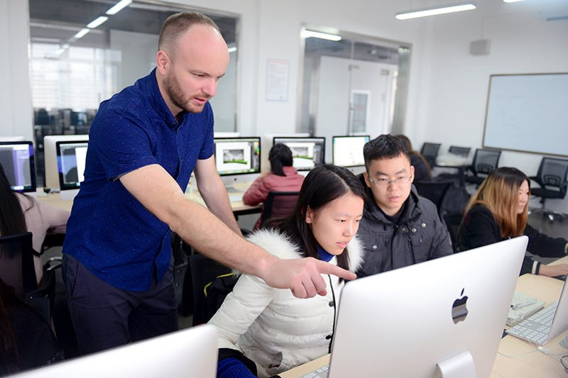 Lecturer helping students