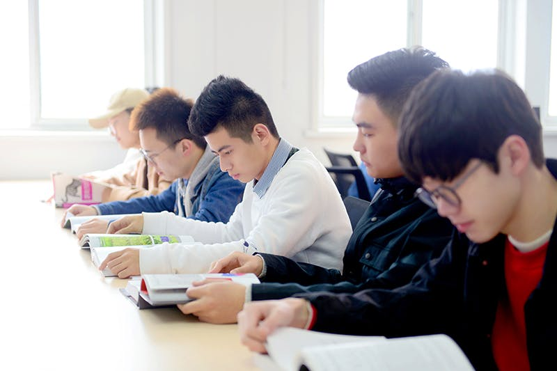 students reading in class