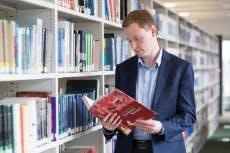 Staff member browsing a book