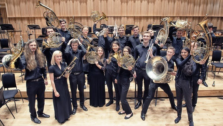 Group of brass student holding up their instruments