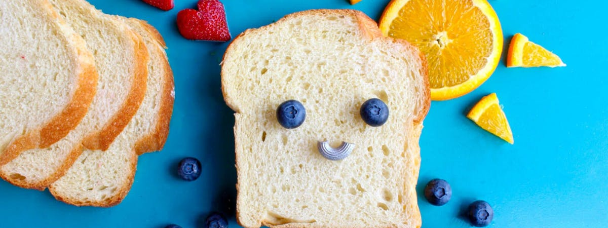 Bread and fruit making a smiling face