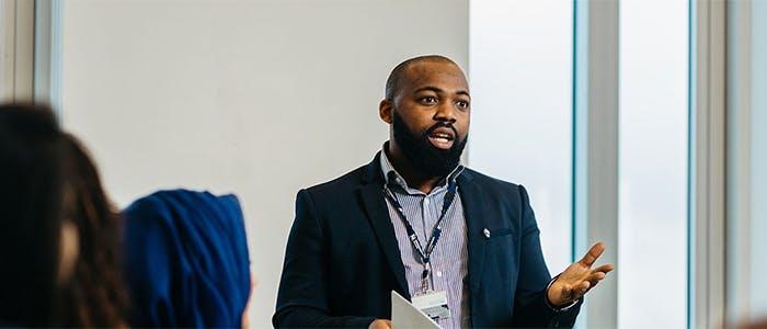 Business Advice Centre 700x300 - Student addressing a class