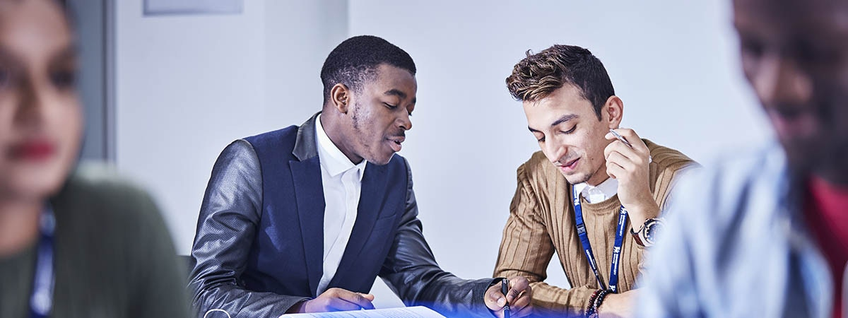 Business (Analytics) Course Image 1200x450 - Two men in conversation