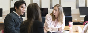 Business - BA (Hons) Course Image 1200 x 450 - Men and women sat at a table