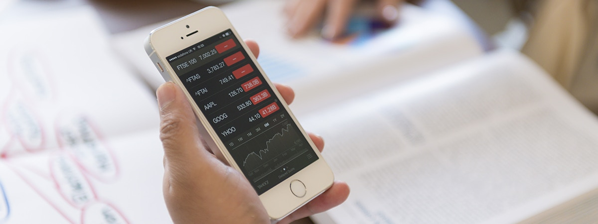 Business Finance - BSc Course Image 1200 x 450 - Phone displaying financial data