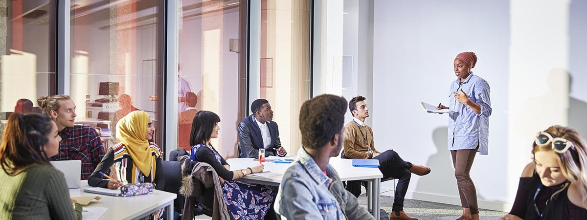 Business Management (Apprenticeship) - BA (Hons) Course Image 1200x450 - People in a classroom
