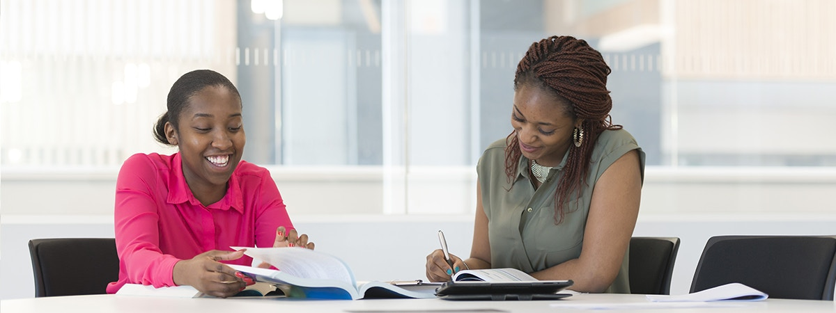 Business Management (Enterprise) - BA (Hons) Course Image 1200x450 - Two women with a laptop