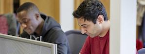 Business Management (Supply Chain Management) - BA (Hons) Course Image 1200x450 - Two men at a desk