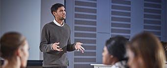Business School Our Staff Nav Image 341x139 - Man addressing a class