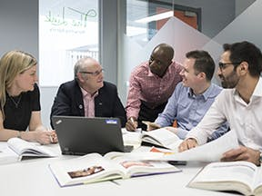Business School Postgraduate Course Page Imagery - Mature students at a table