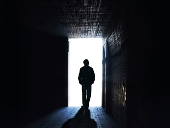 Centre for Applied Criminology Positive Criminology Page Image 350x263 - Man in silhouette stood in a doorway