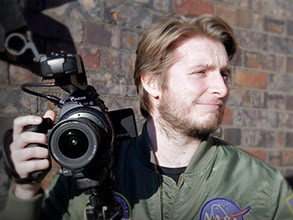 Callum Hodgkinson with a Canon C100 video camera.