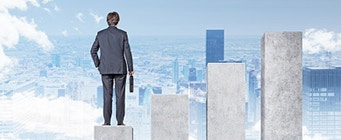 Centre for Enterprise, Innovation and Growth Homepage Image 341x140 - Man stood on building blocks looking at a city