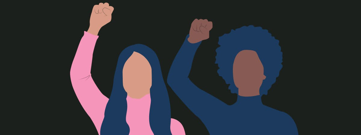 Two women with their arms raised to reflect the international womens day theme of choose to challenge