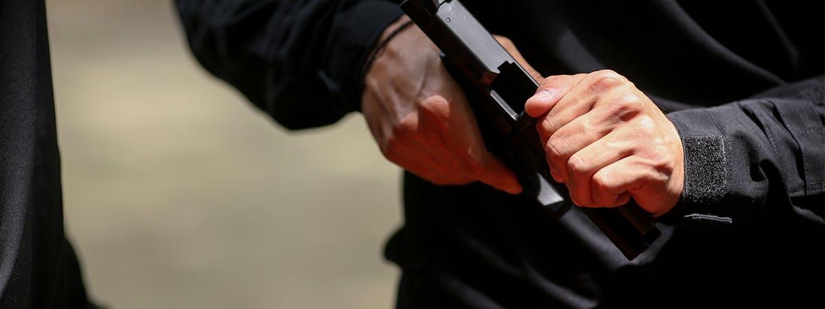 Man loading a handgun