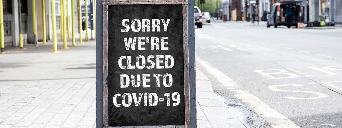 """Covid Hospitality 1200x450 - Board saying """"Sorry we're closed due to COVID-19"""""""