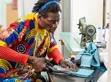 A Senegalese craft maker working.
