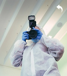 Social Sciences - Homepage - Facilities - Crime Scene Room - Man in a labcoat with a camera
