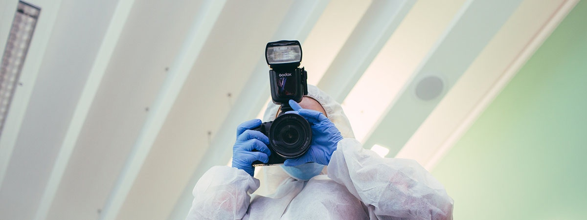 Criminology Course Image 1200x450 - Person in a crime scene suit
