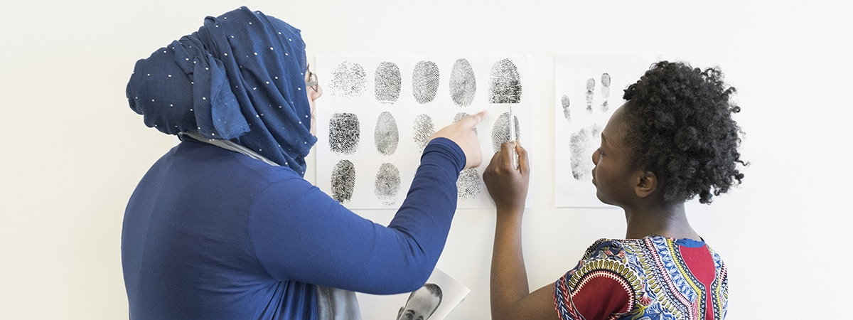 Criminology and Security Studies - BA Course Image 1200 x 450 - Two women looking at fingerprints