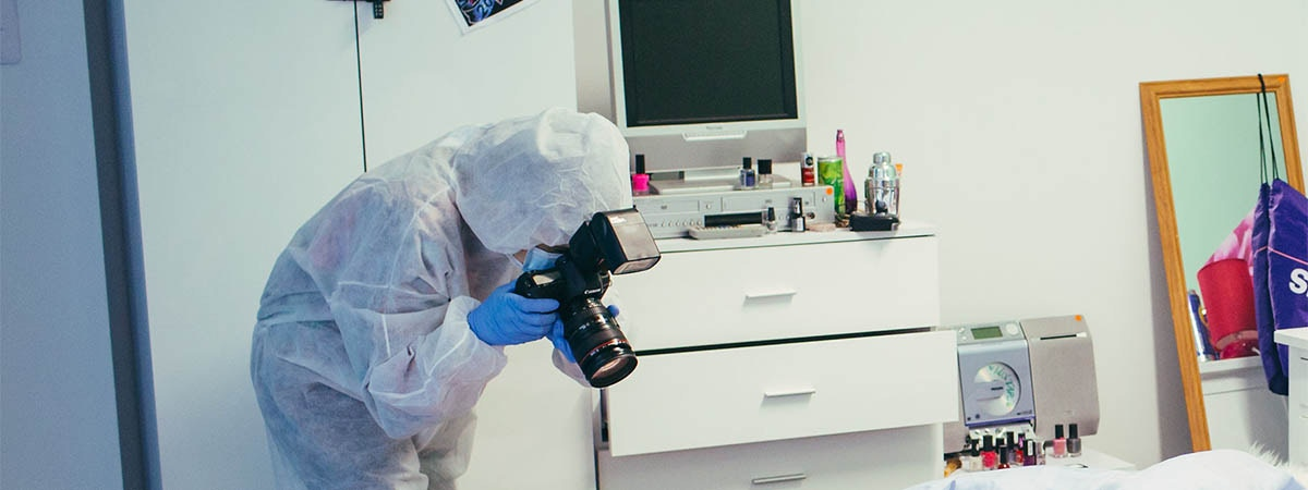 Criminology, Policing and Investigation Course Image 1200x450 - Person in a crime scene suit