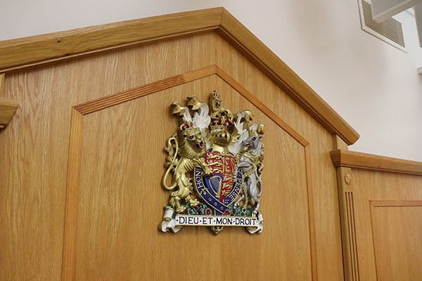 Crown Court 4 600x400 - Close up of coat of arms