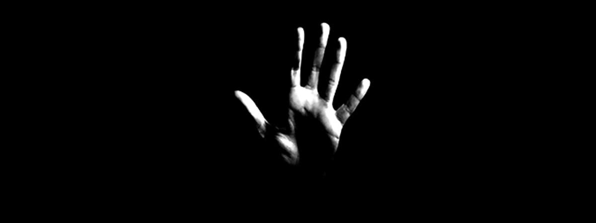 Domestic Abuse Liz Yardley Blog 1200x450 - Hand against a black backdrop