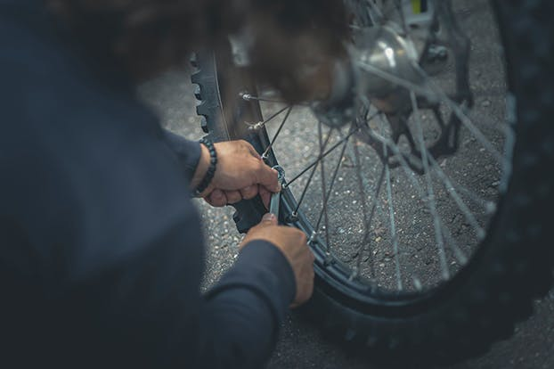 Bicycle wheel being worked on by a mechanic